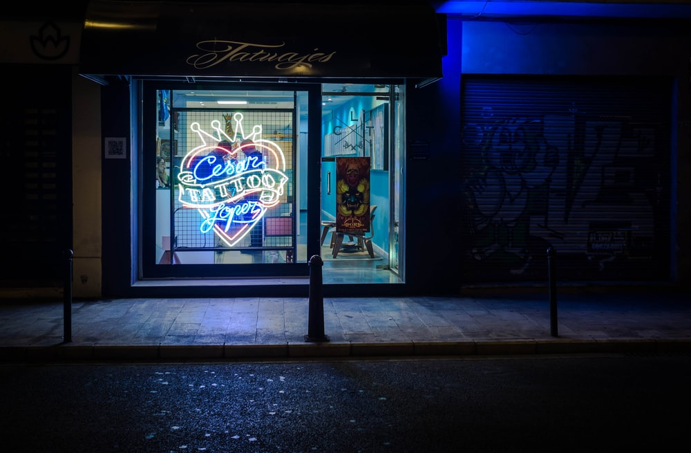 landscape photography of neon tattoo sign during nighttime