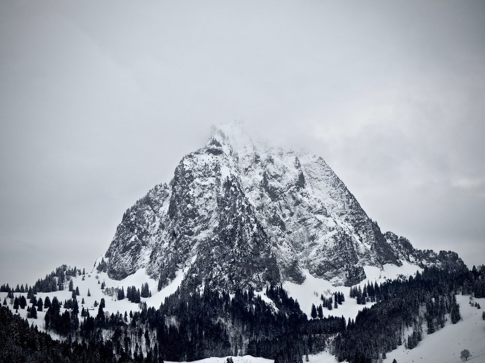 mountain covered by snow at daytime