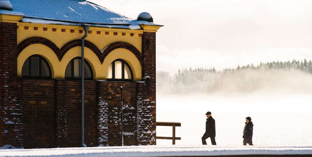 men walking towards concrete structure