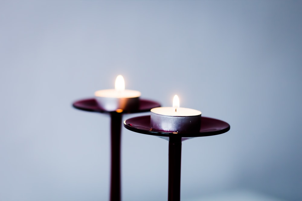 two lit tealight candles