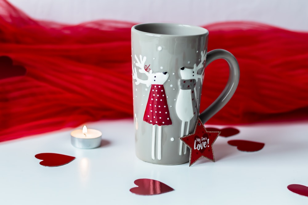 grey and white reindeer print ceramic mug