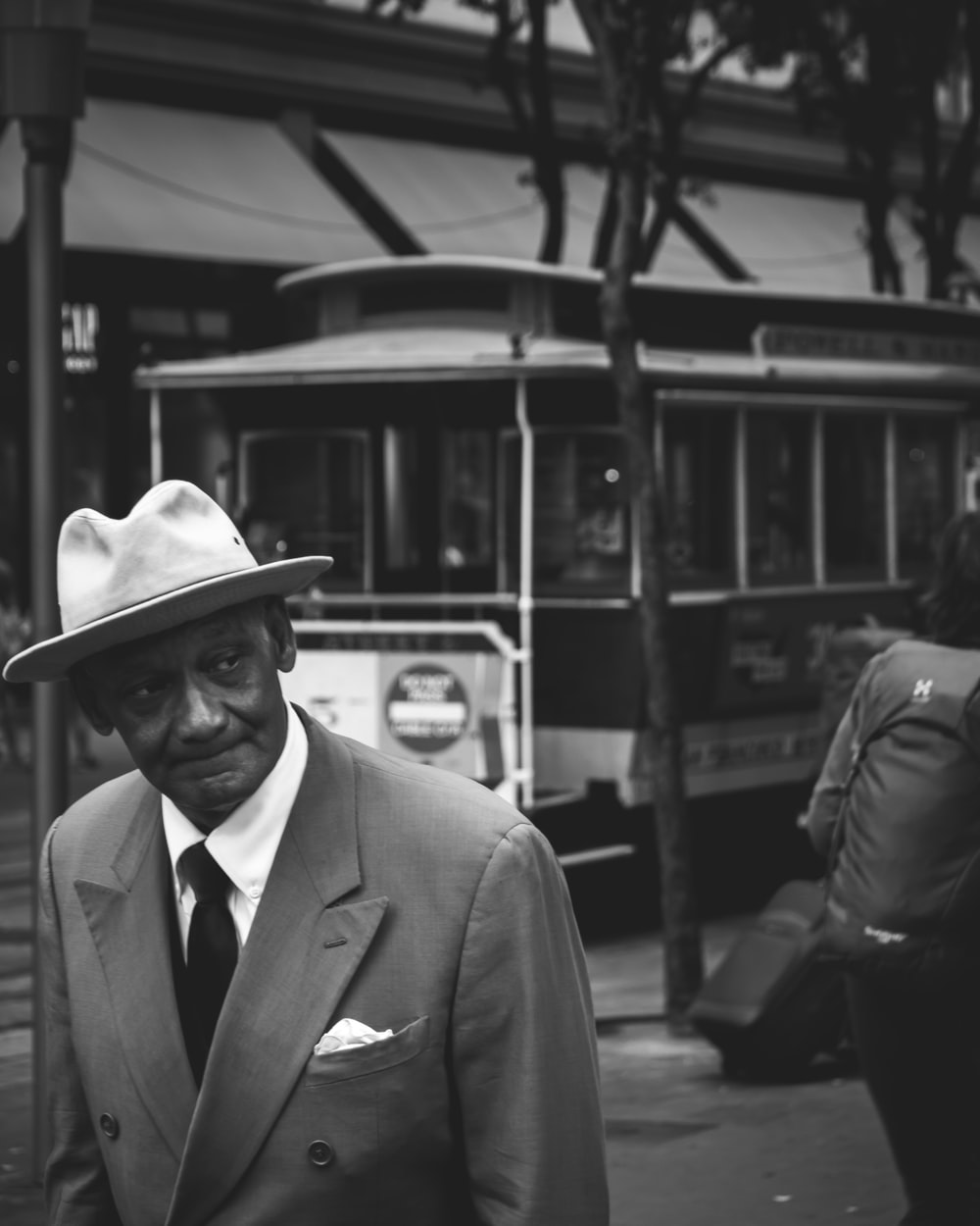grayscale photo of man wearing suit jacket