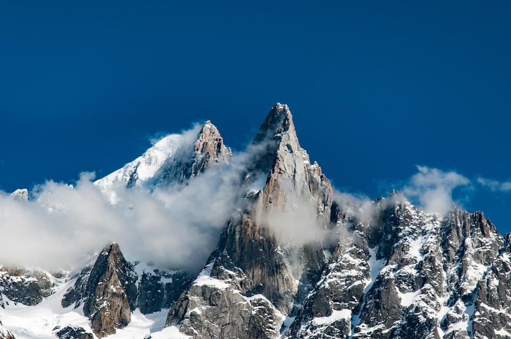 snowy mountain summit during daytime