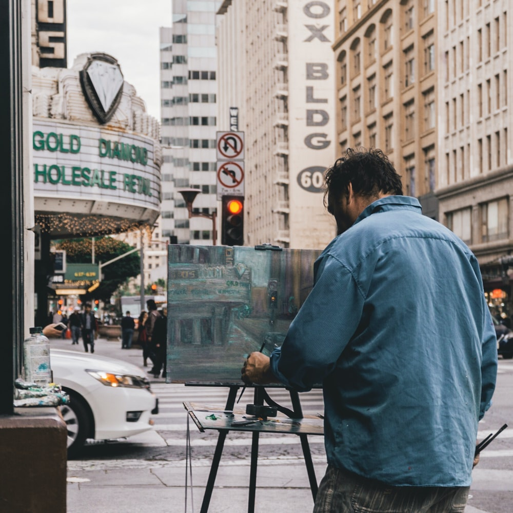 man painting the city