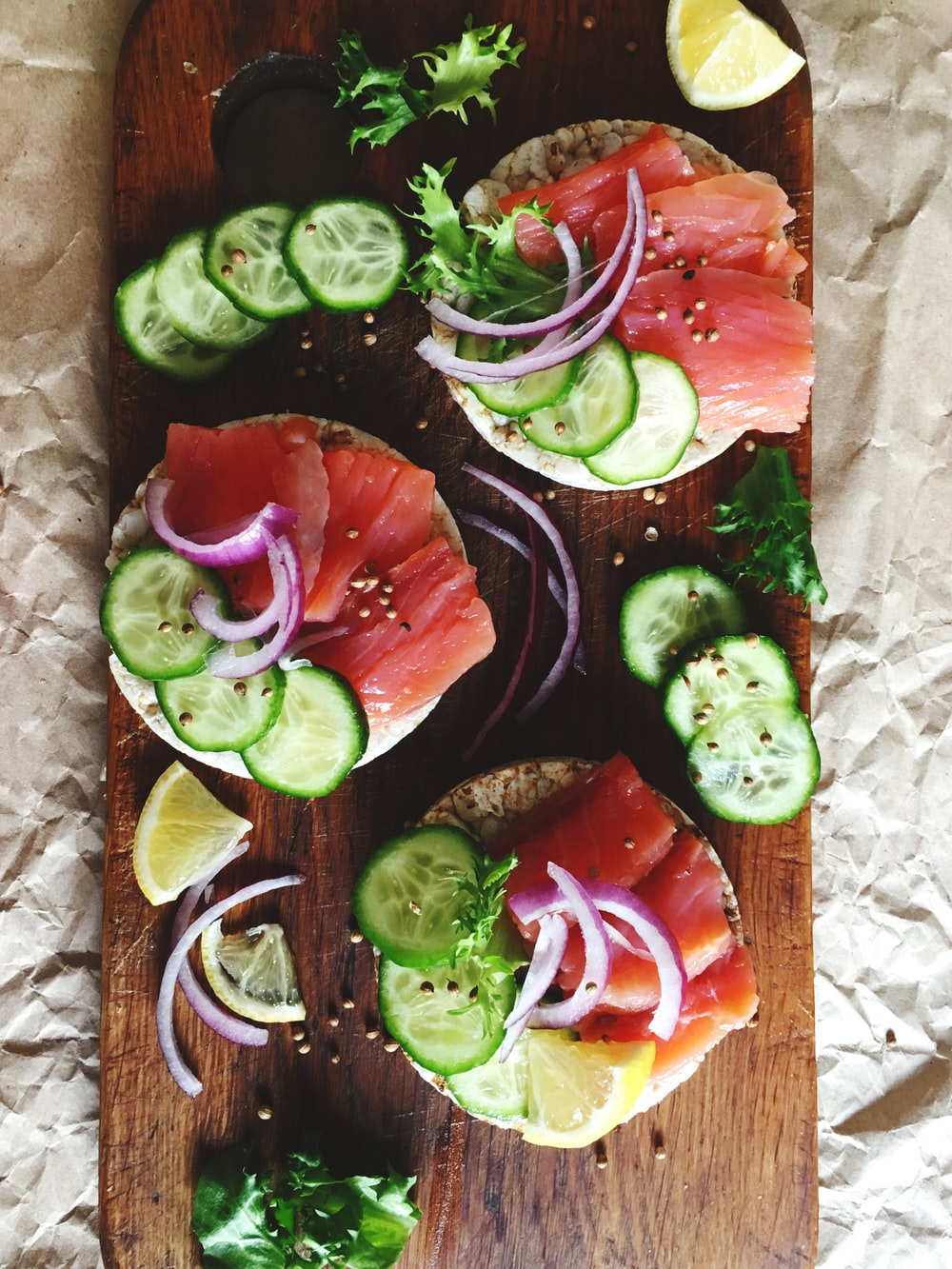 raw fish filet with vegetable and spices on chopping board