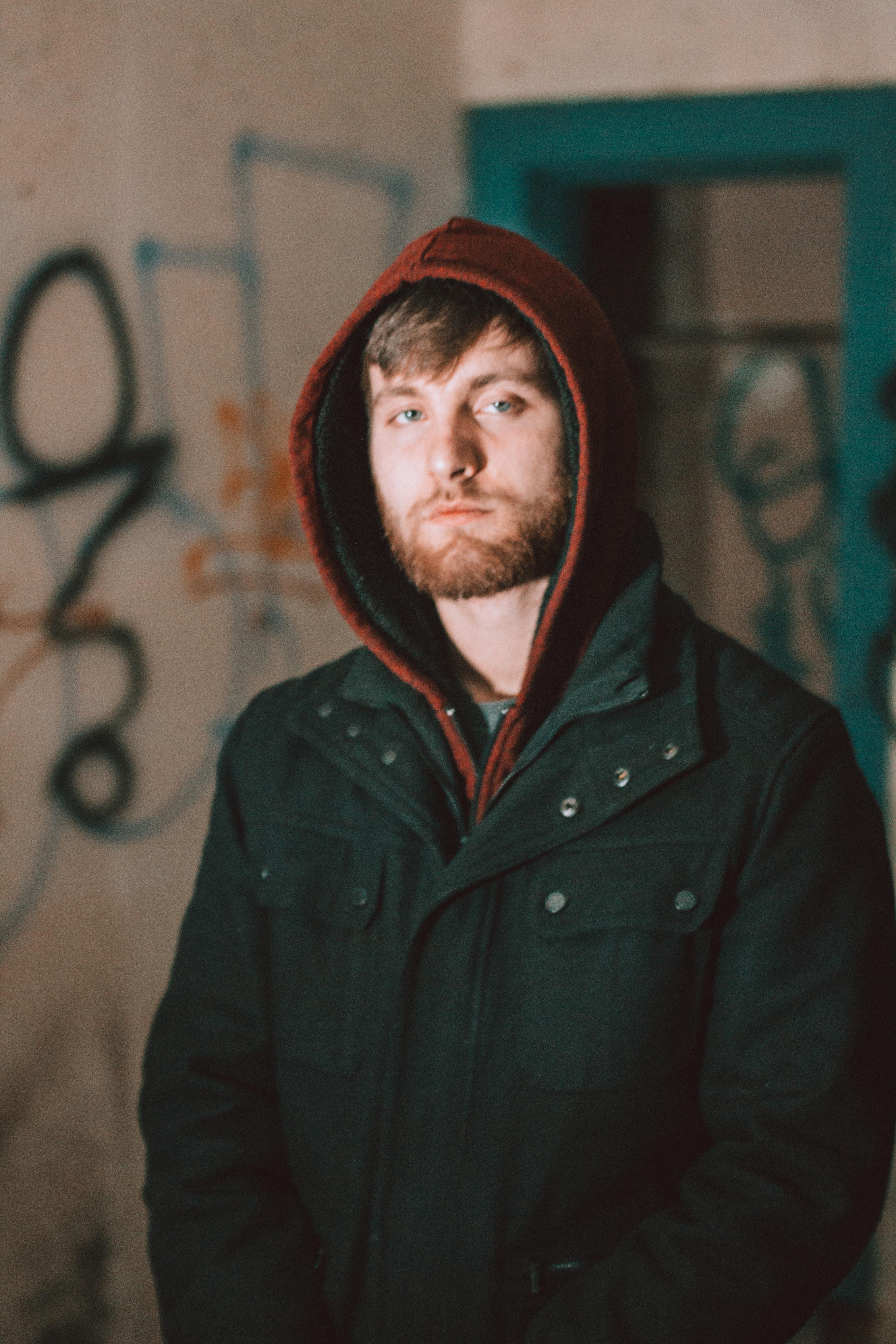man wearing black and red zip-up hoodie
