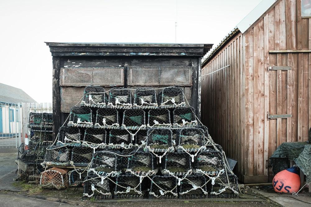 pile of animal cage near barn
