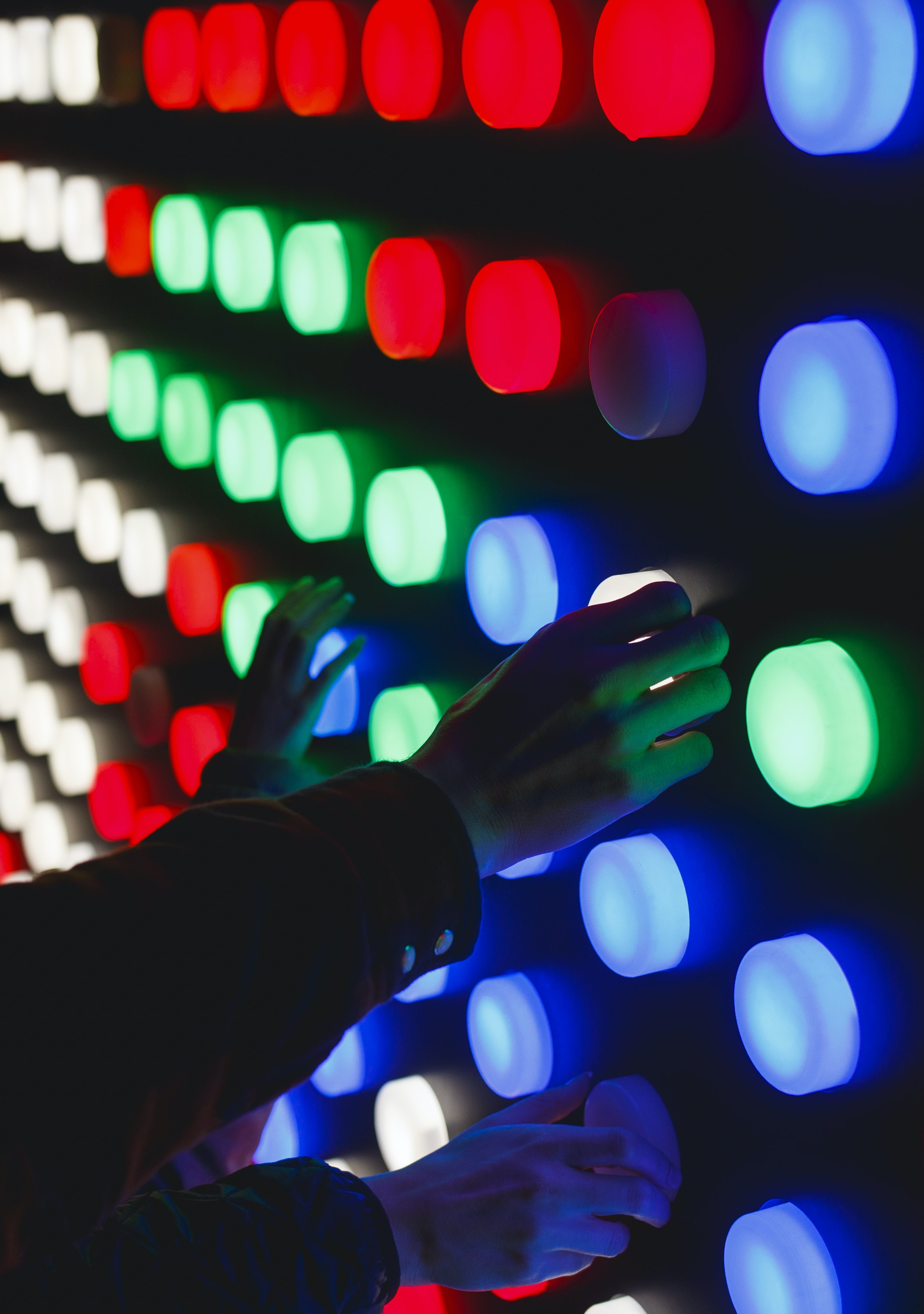 people holding assorted-color LED lights