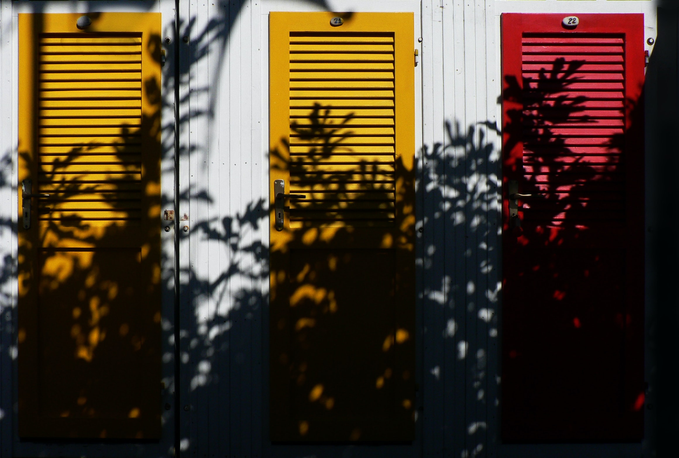 yellow and red wooden closed doors