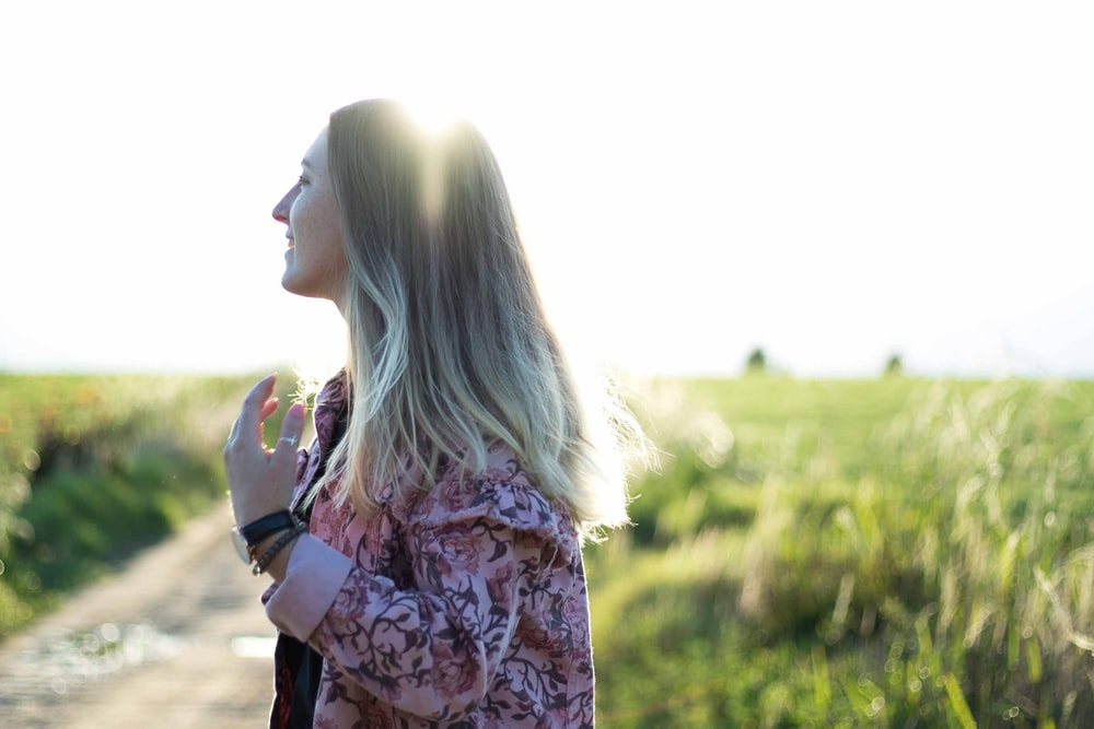 woman posing under sunny sky