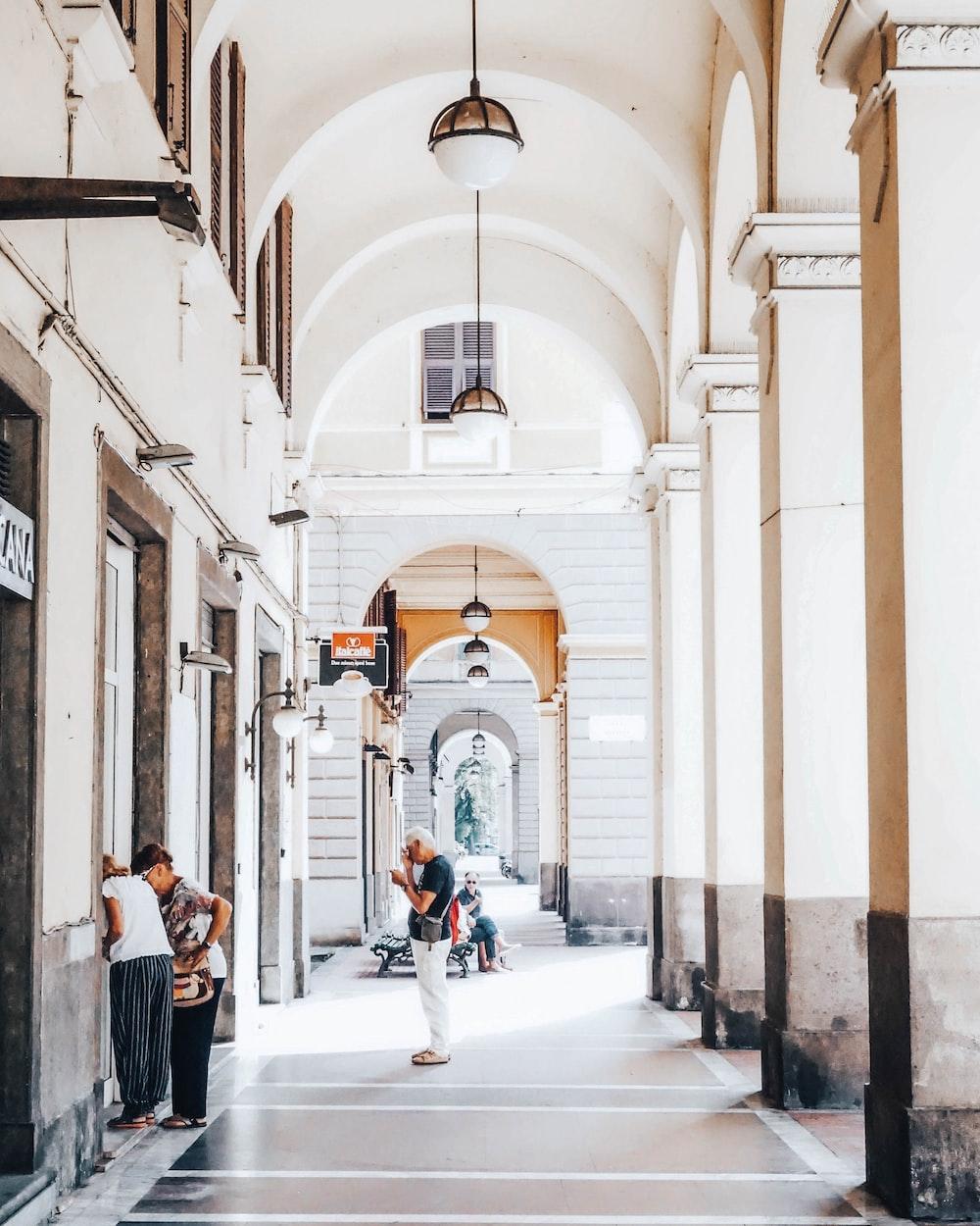 people standing on hallway