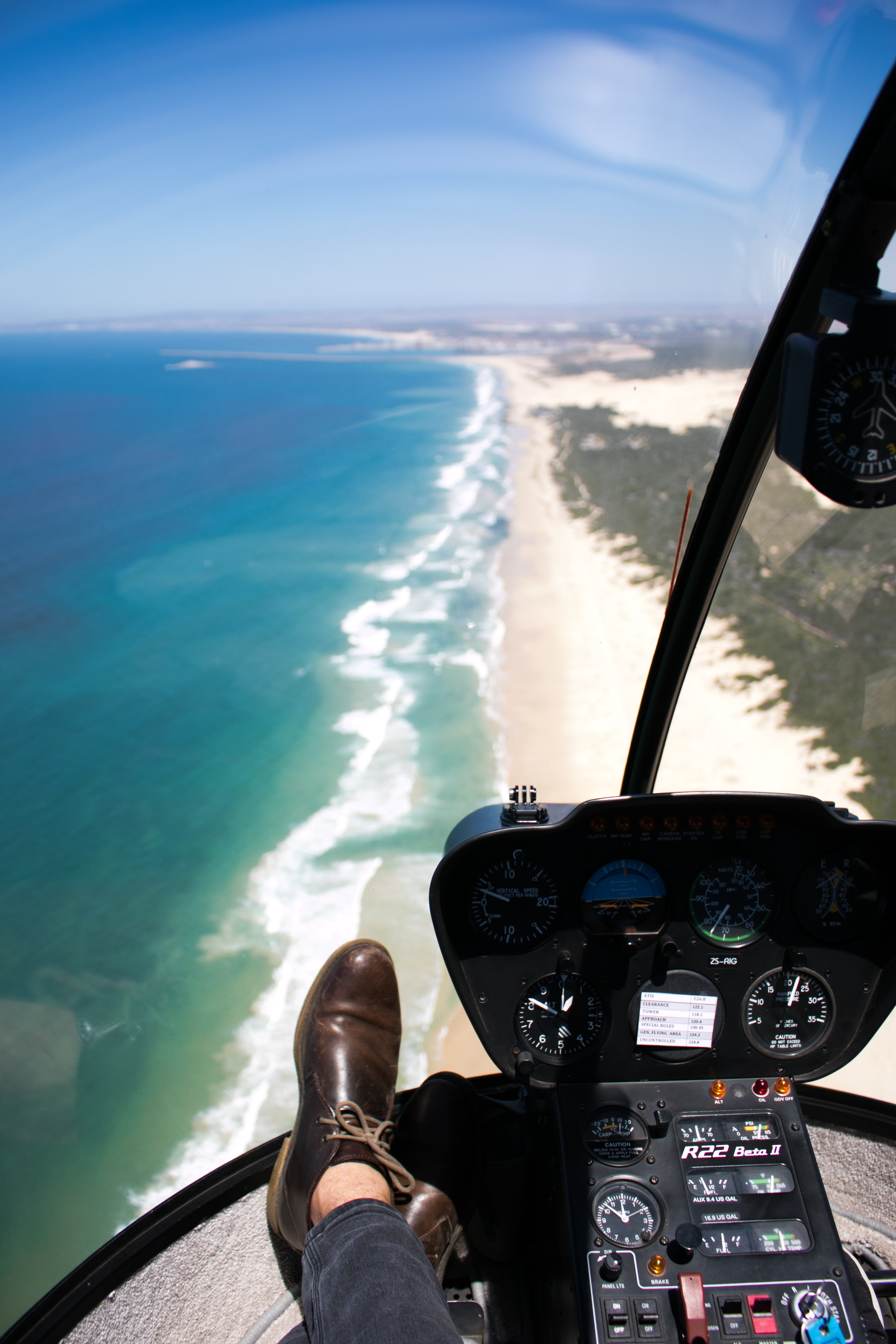 person inside aircraft over beach