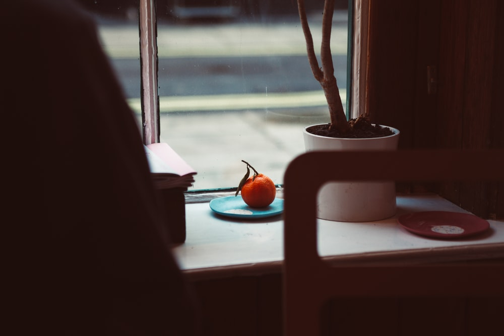 orange fruit on saucer