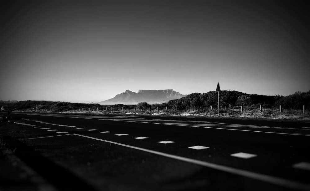 empty road in grayscale photography