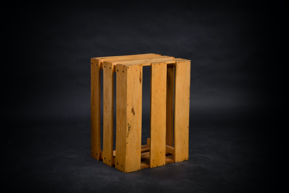 brown wooden crate with black background