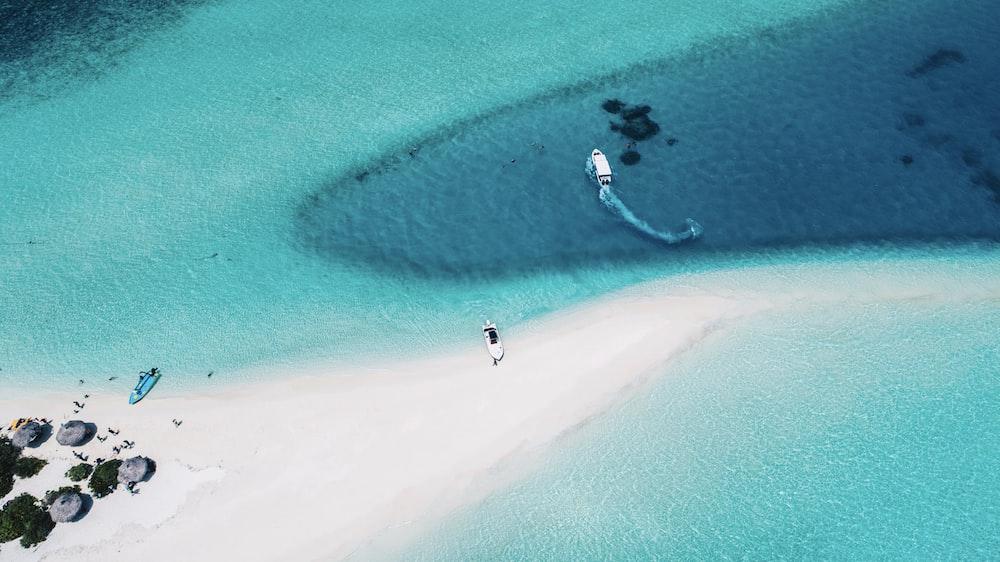 three motorized boats on sea aerial photography