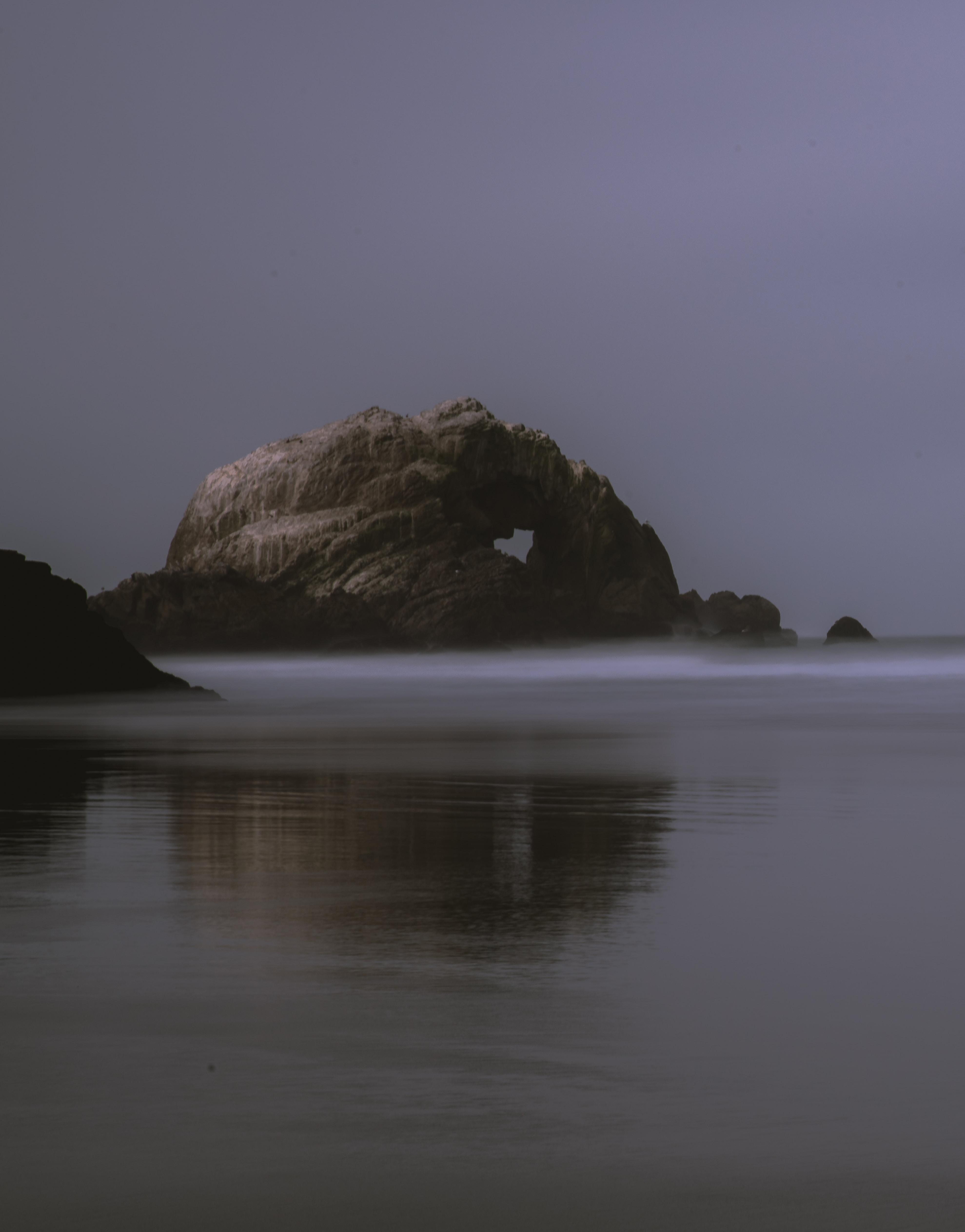 rock formation under gray sky