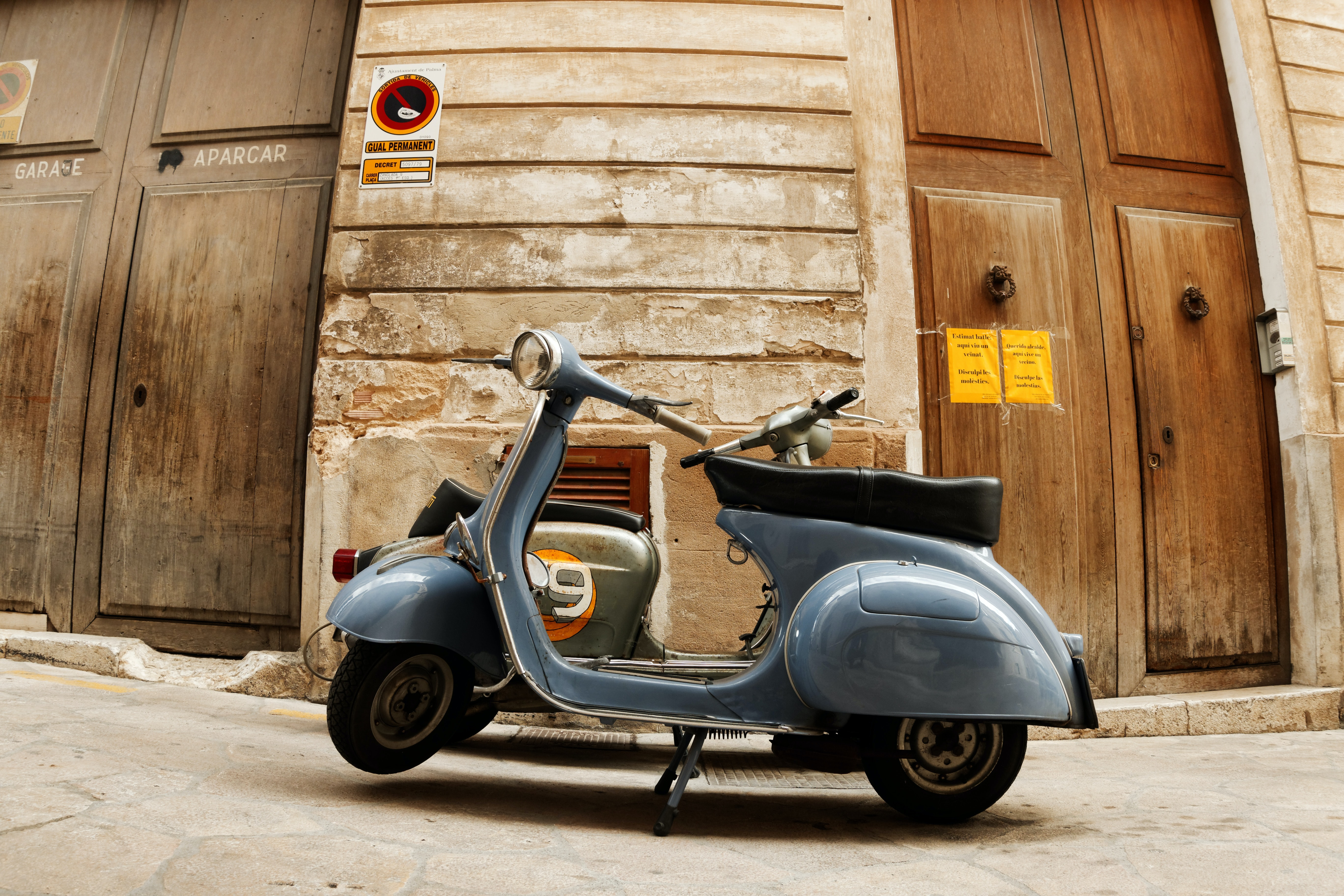 landscape photograph of classic gray motor scooter