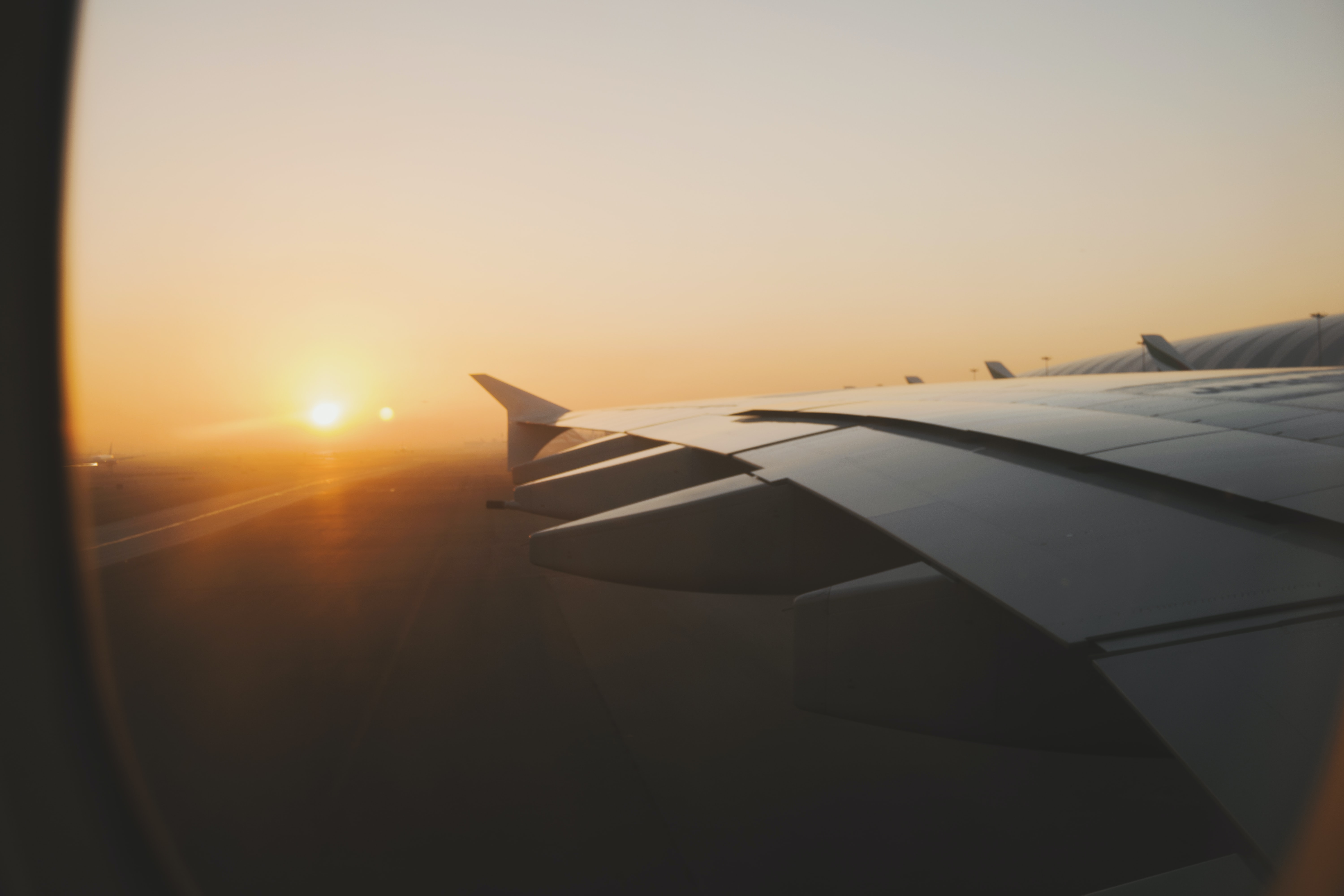 left side wing of airplane during golden hour