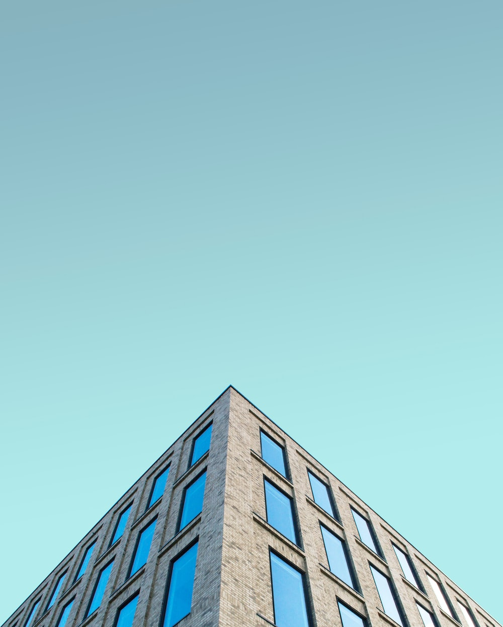 low angle photography of brown building structrure