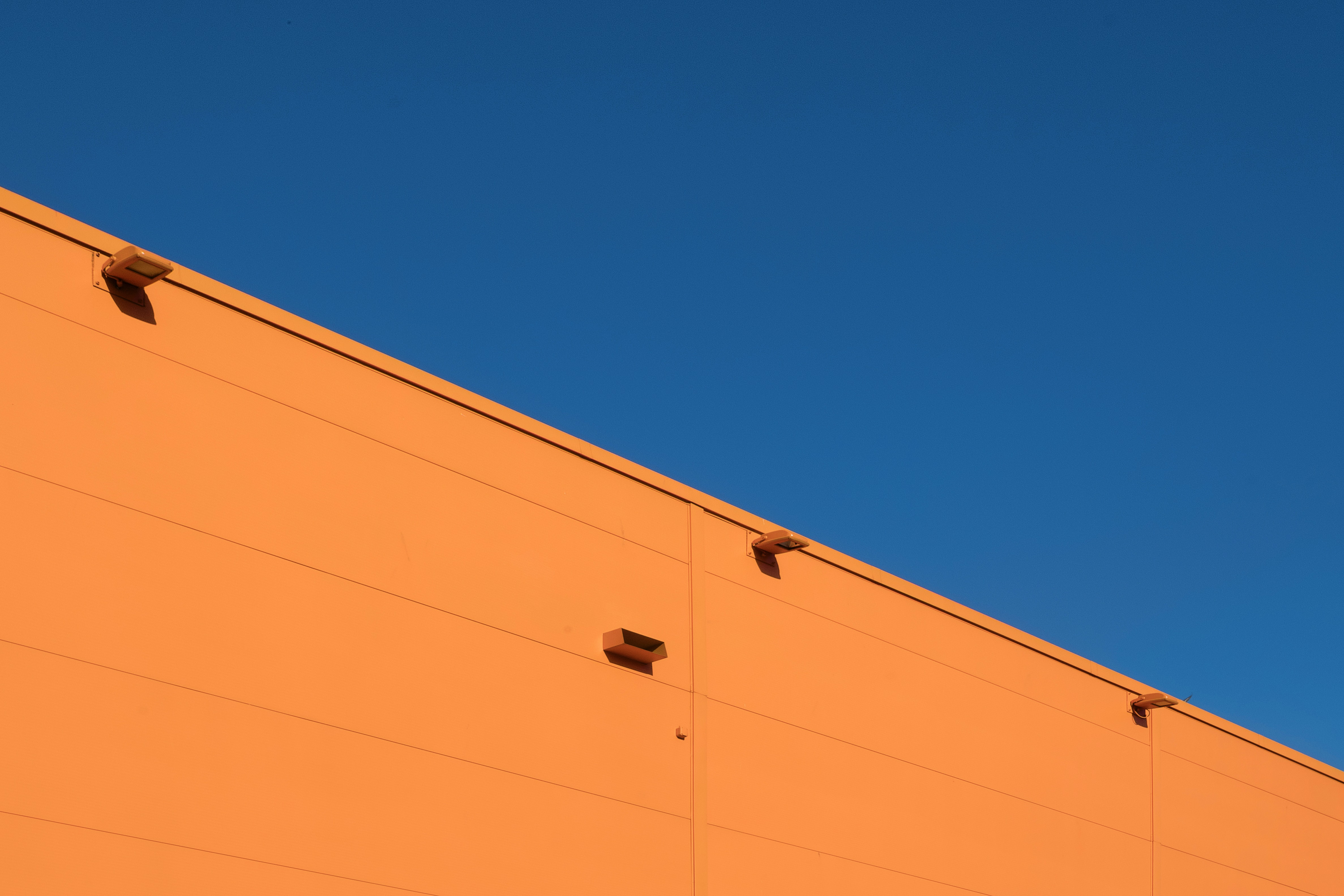 architectural photography of orange concrete structure