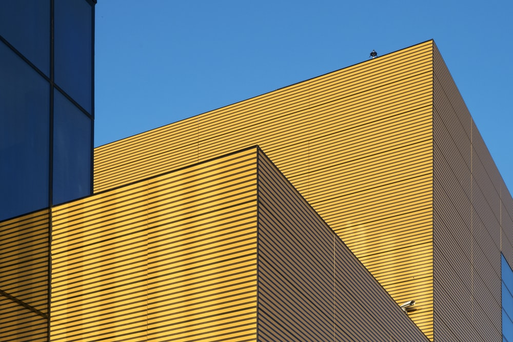 yellow building under clear blue sky during daytime
