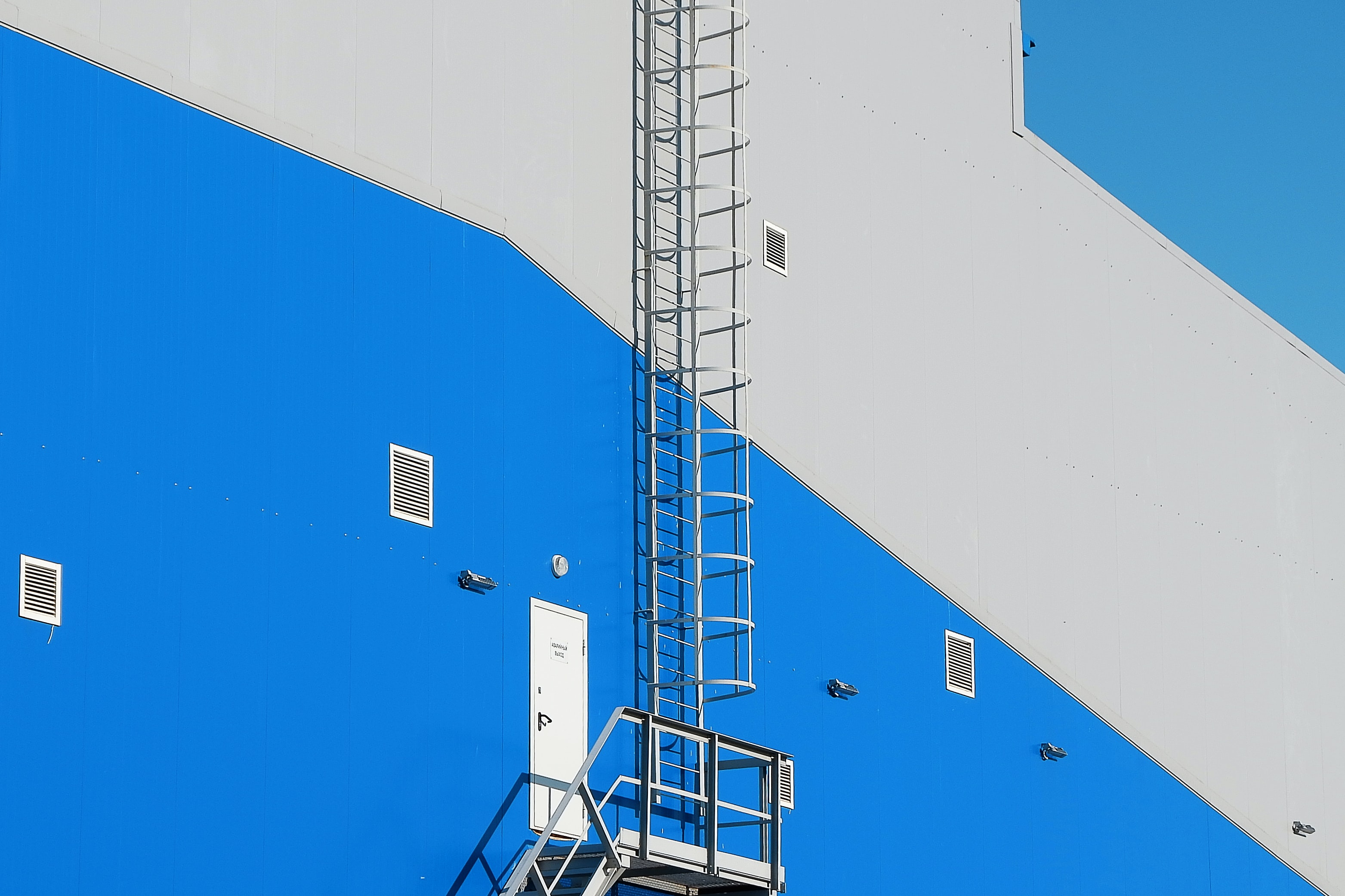 gray and blue building fire exit