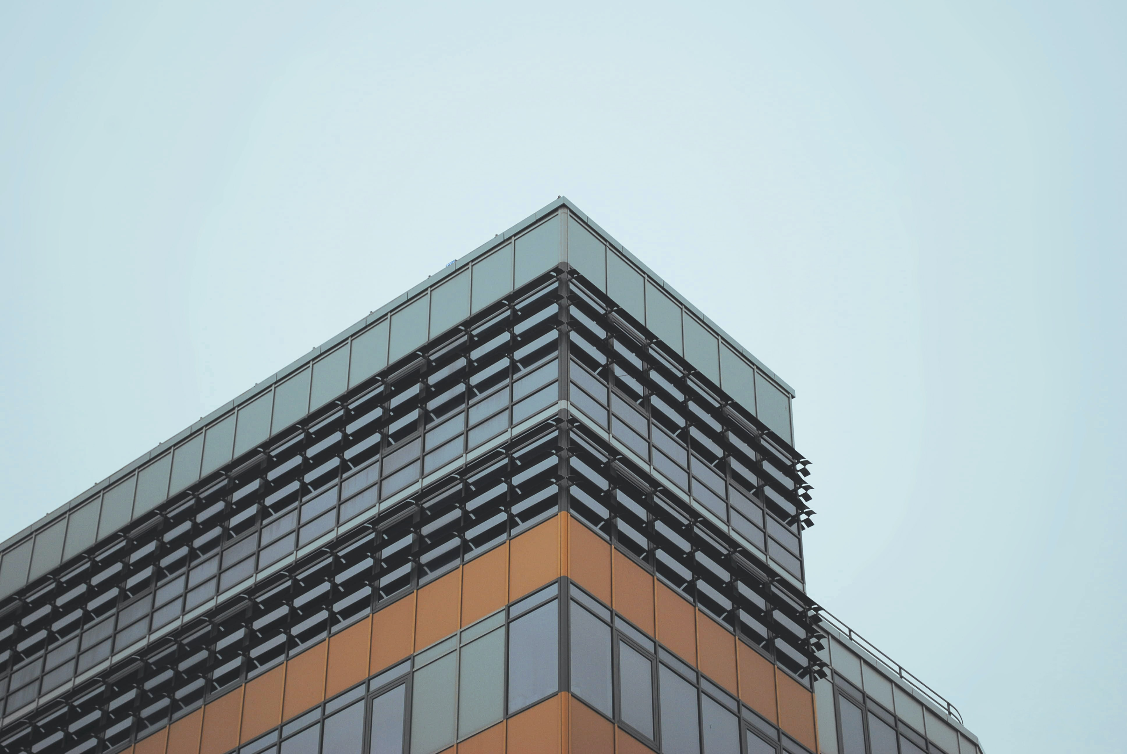 low-angled photography of concrete building under cloudy sky