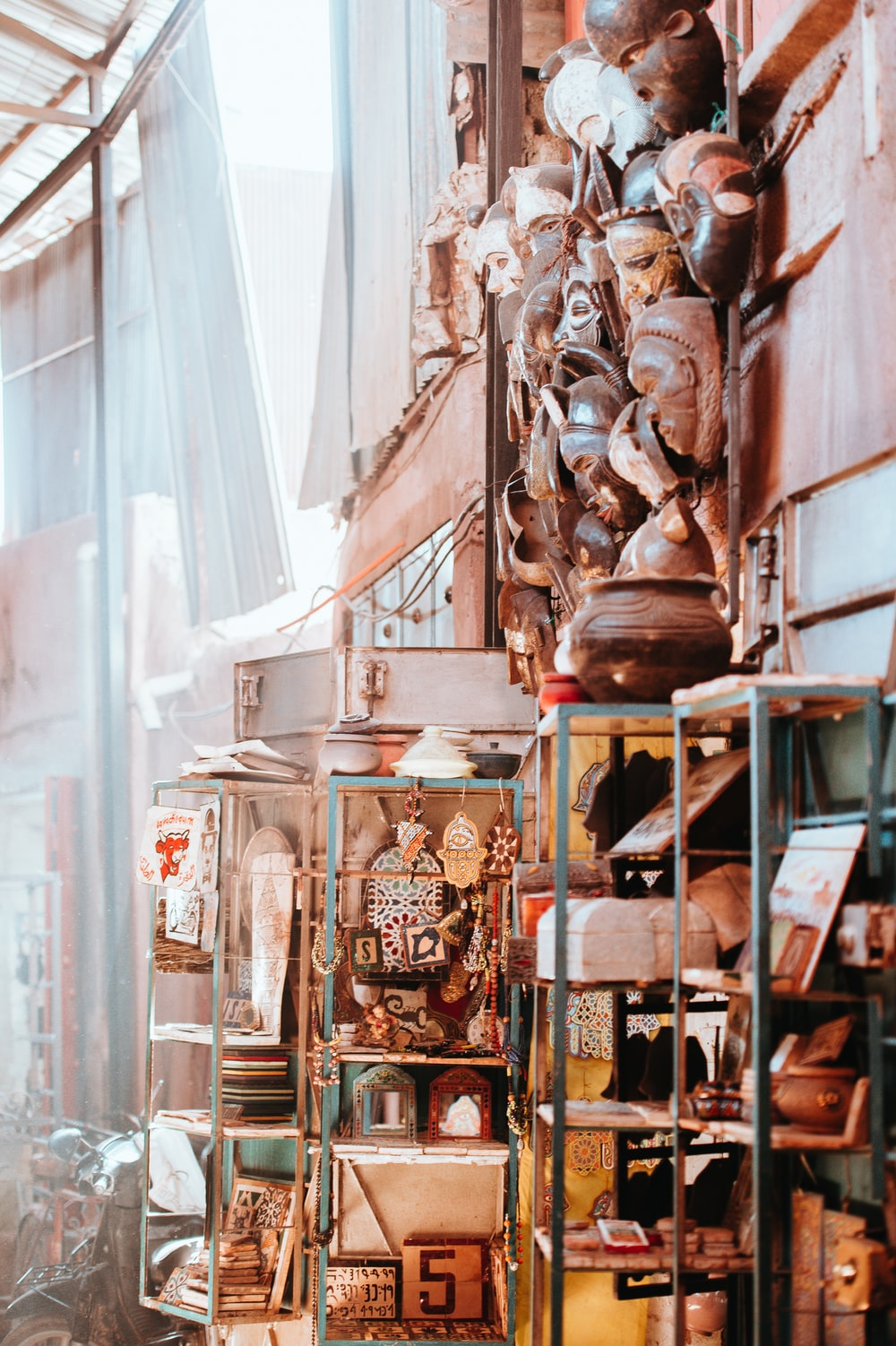 shelf of decorative masks and home ornaments