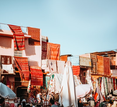 assorted-color textiles hanging on roof