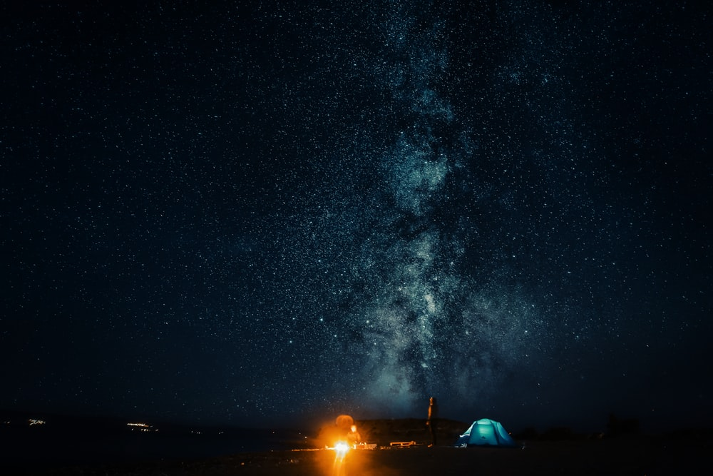 landscape photo of camping tents under starry nighttime