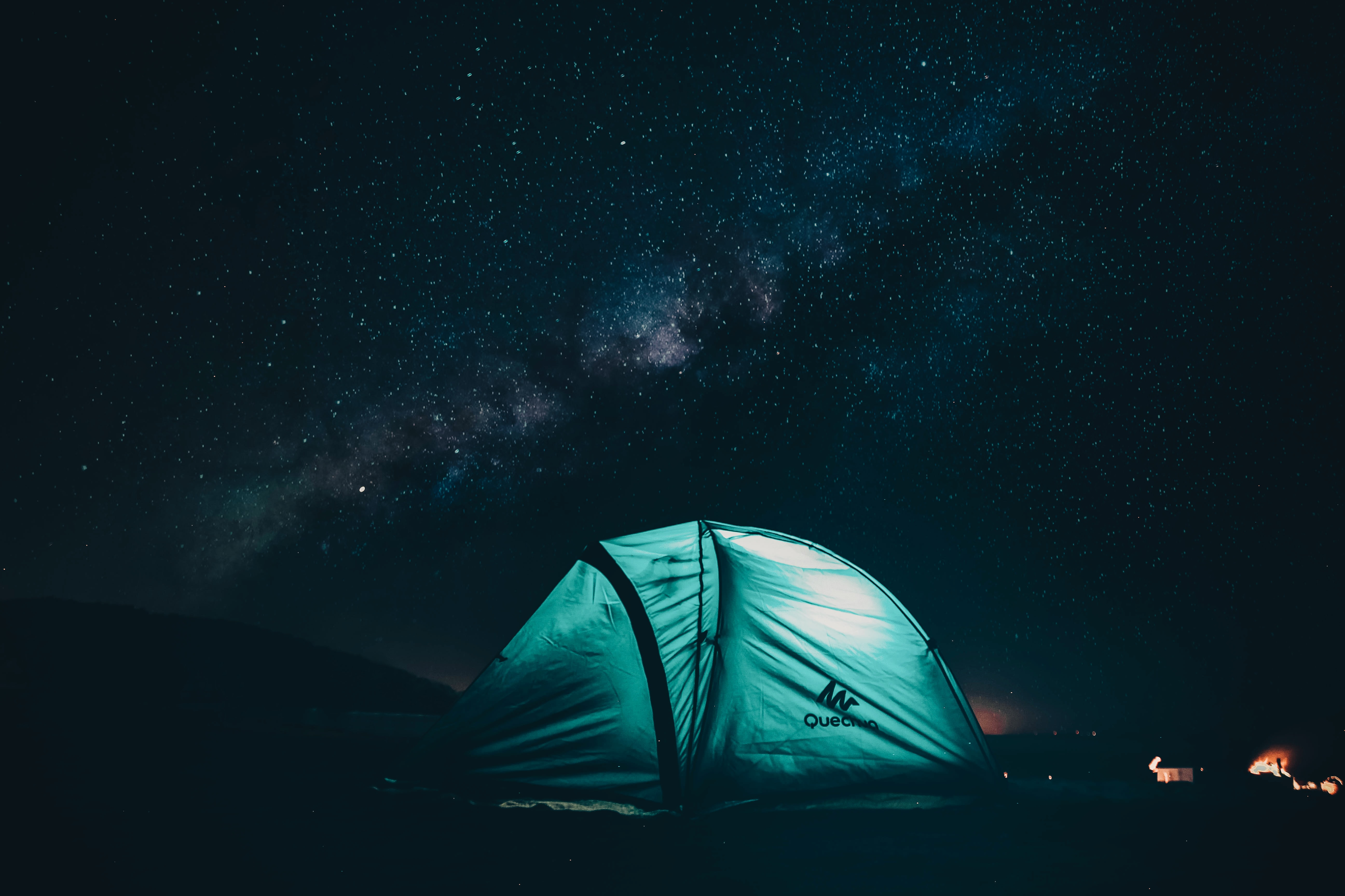 green and black tent with light inside under starry sky during nighttime
