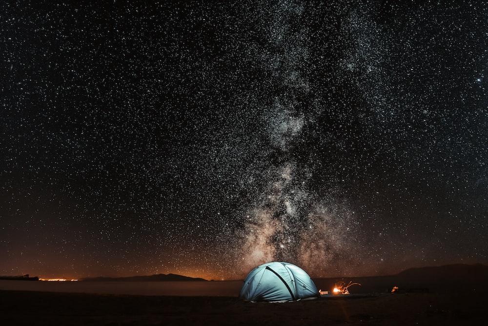 blue tent under milkyway