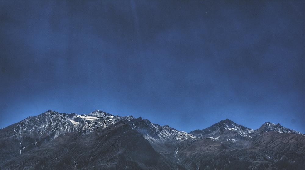 mountain range under blue sky