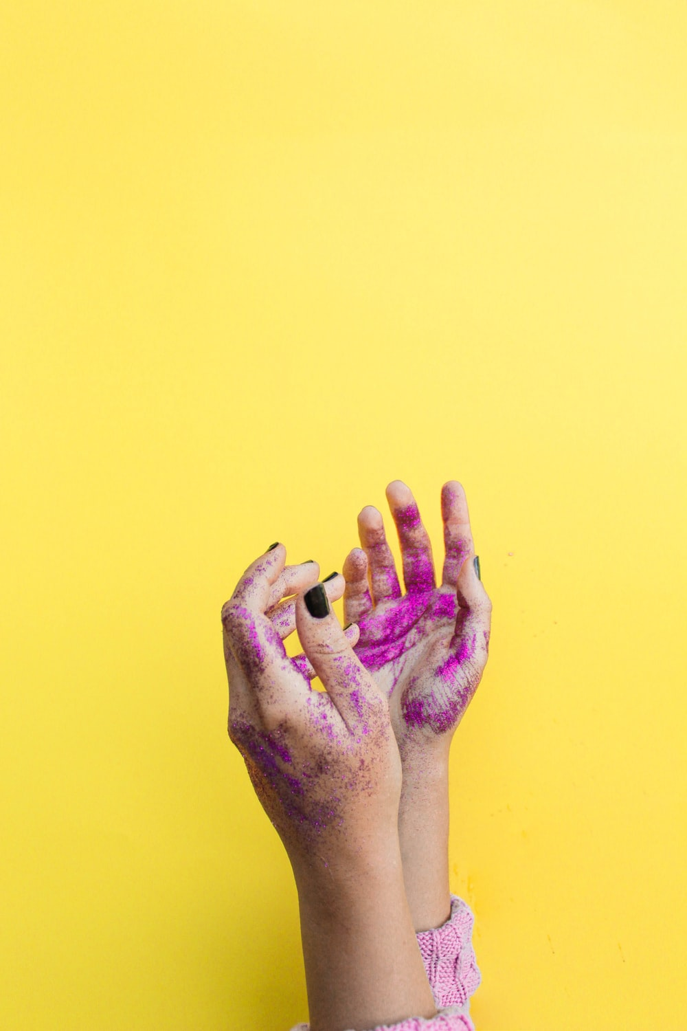 person showing pink painted both hands