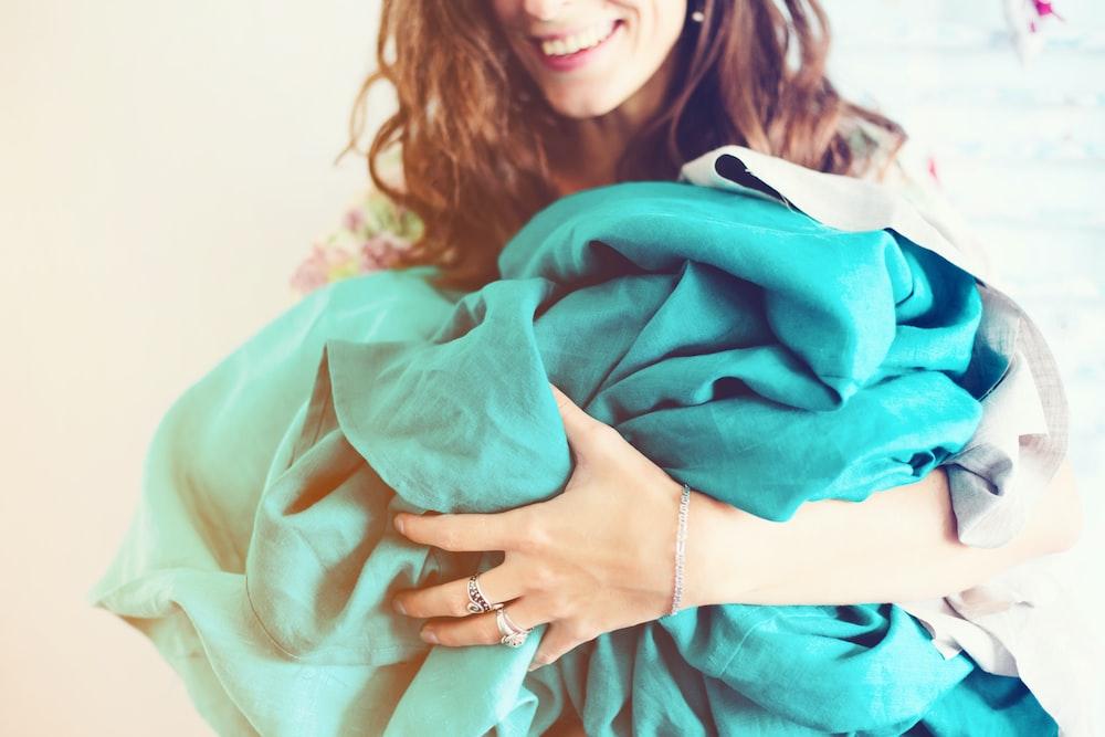woman holding blue textile