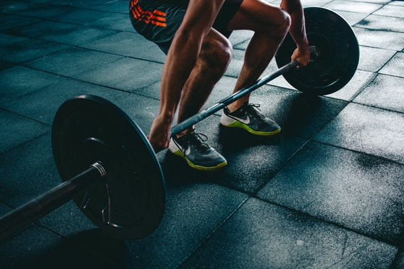 A man dead-lifting a heavy weight