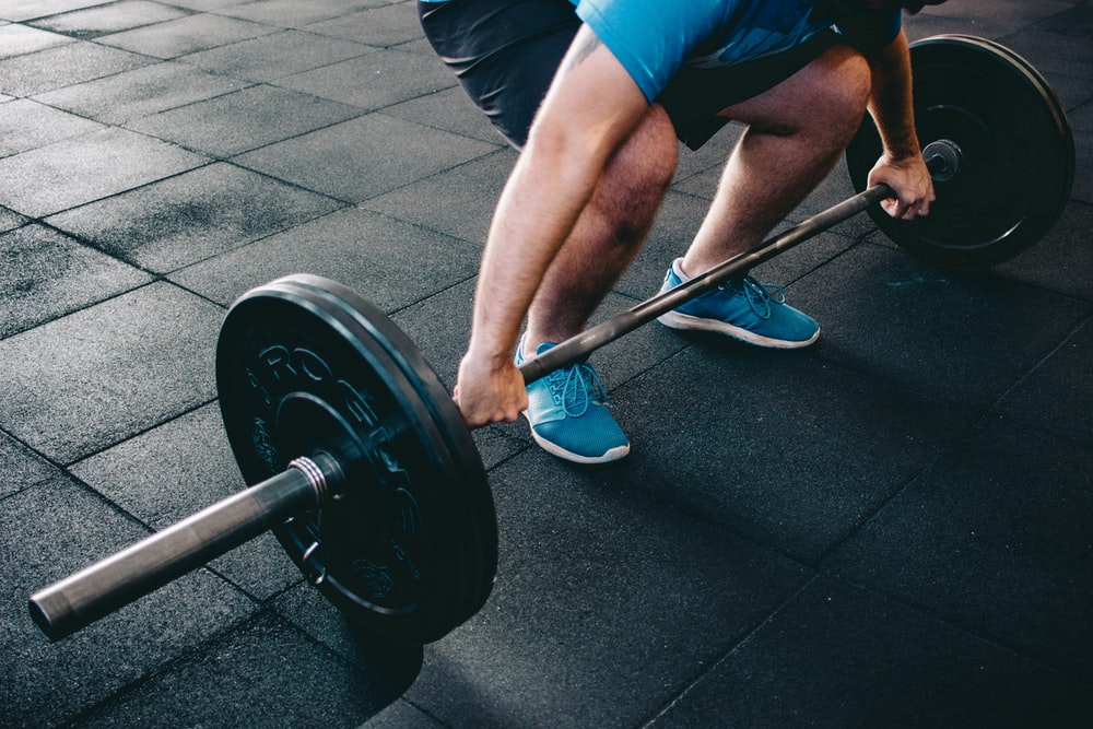 person about to lift barbell