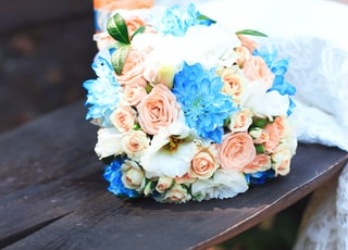 assorted-color flowers bouquet on bench