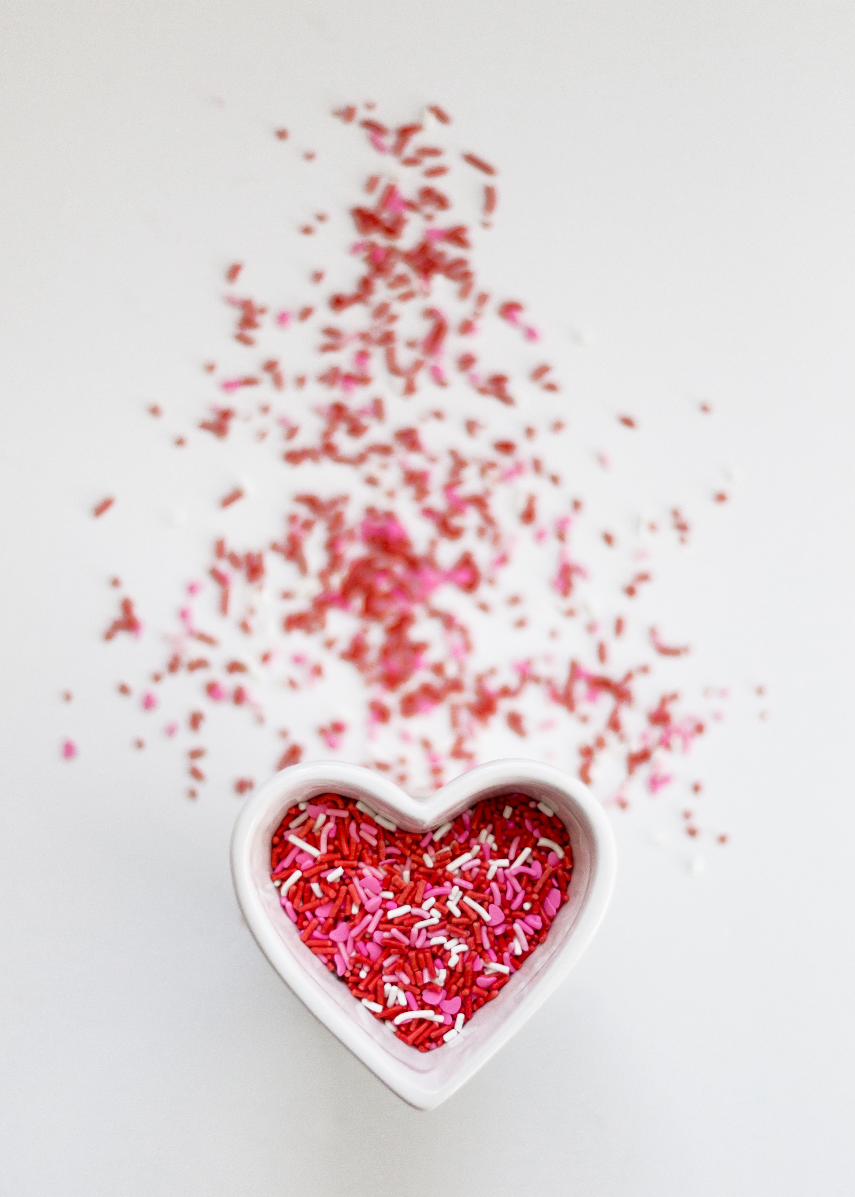 selective focus photo ofsprinkles in heart ceramic bowl