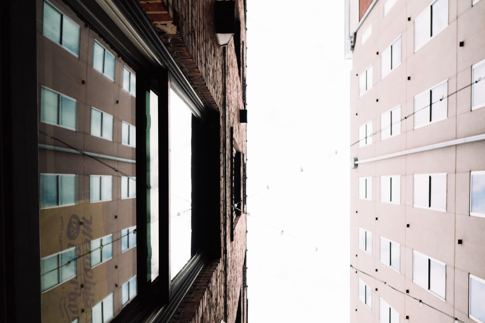 low angle photography of two high-rise buildings