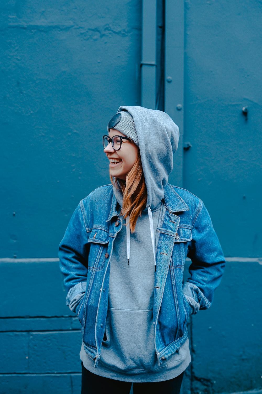 woman standing near blue steel gate