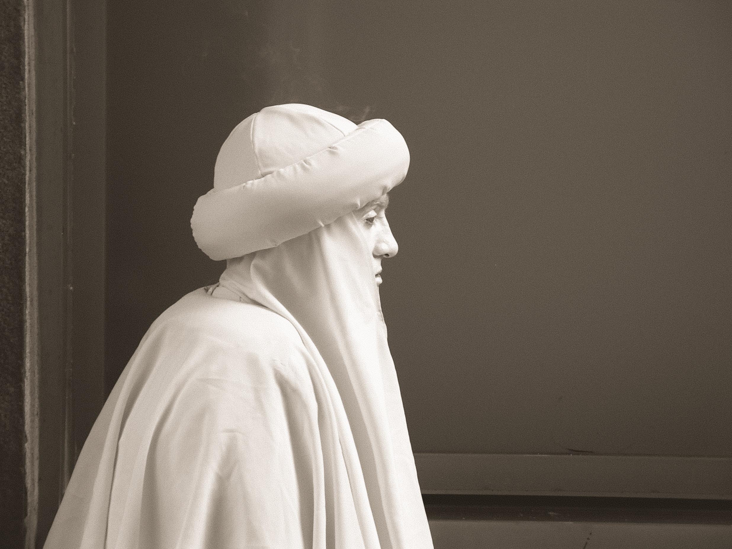 man in white garments