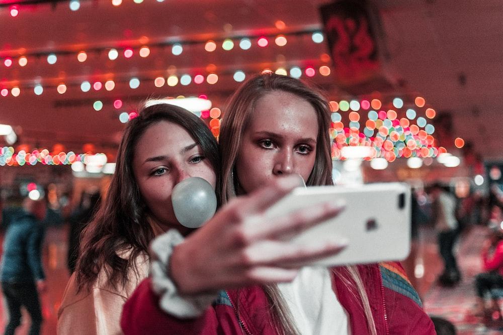 women takes photo inside building near people