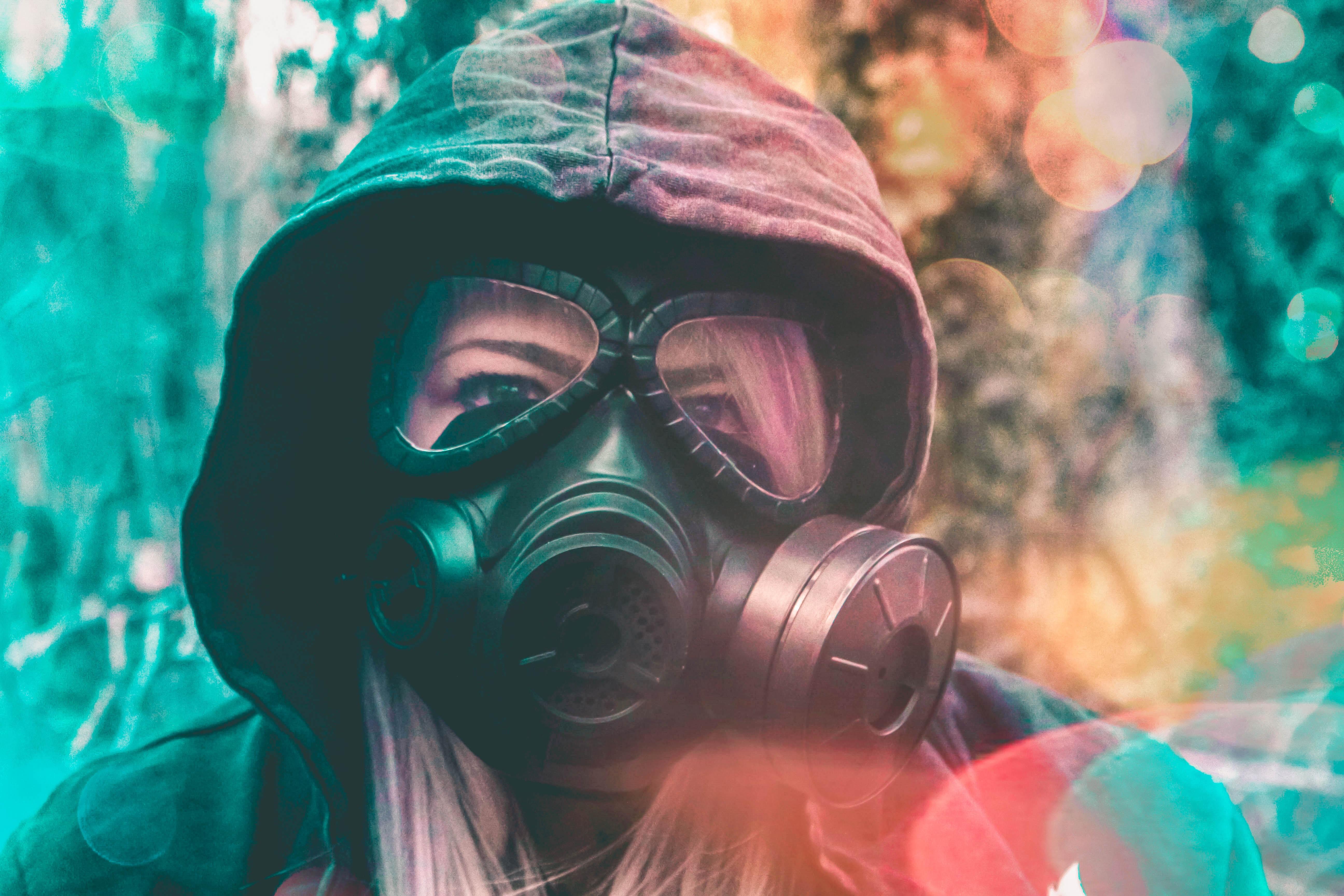 woman wears respirator and black hoodie