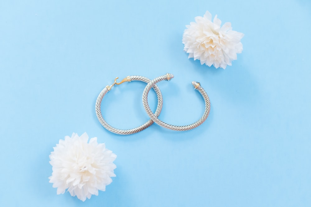 two silver-colored bangles