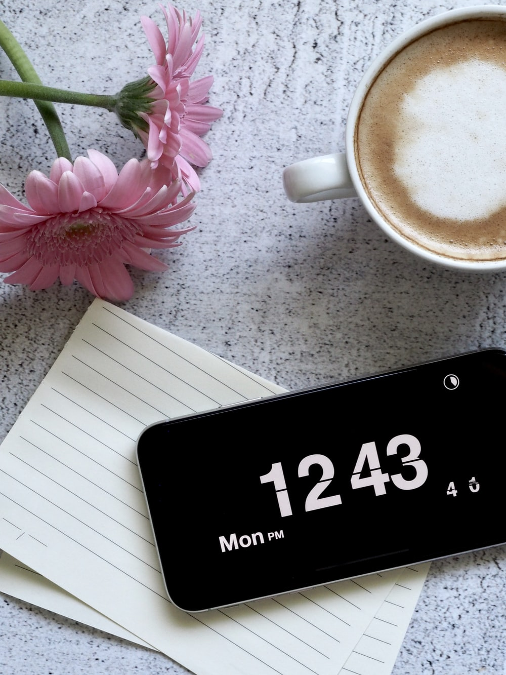 black smartphone displaying 12:43