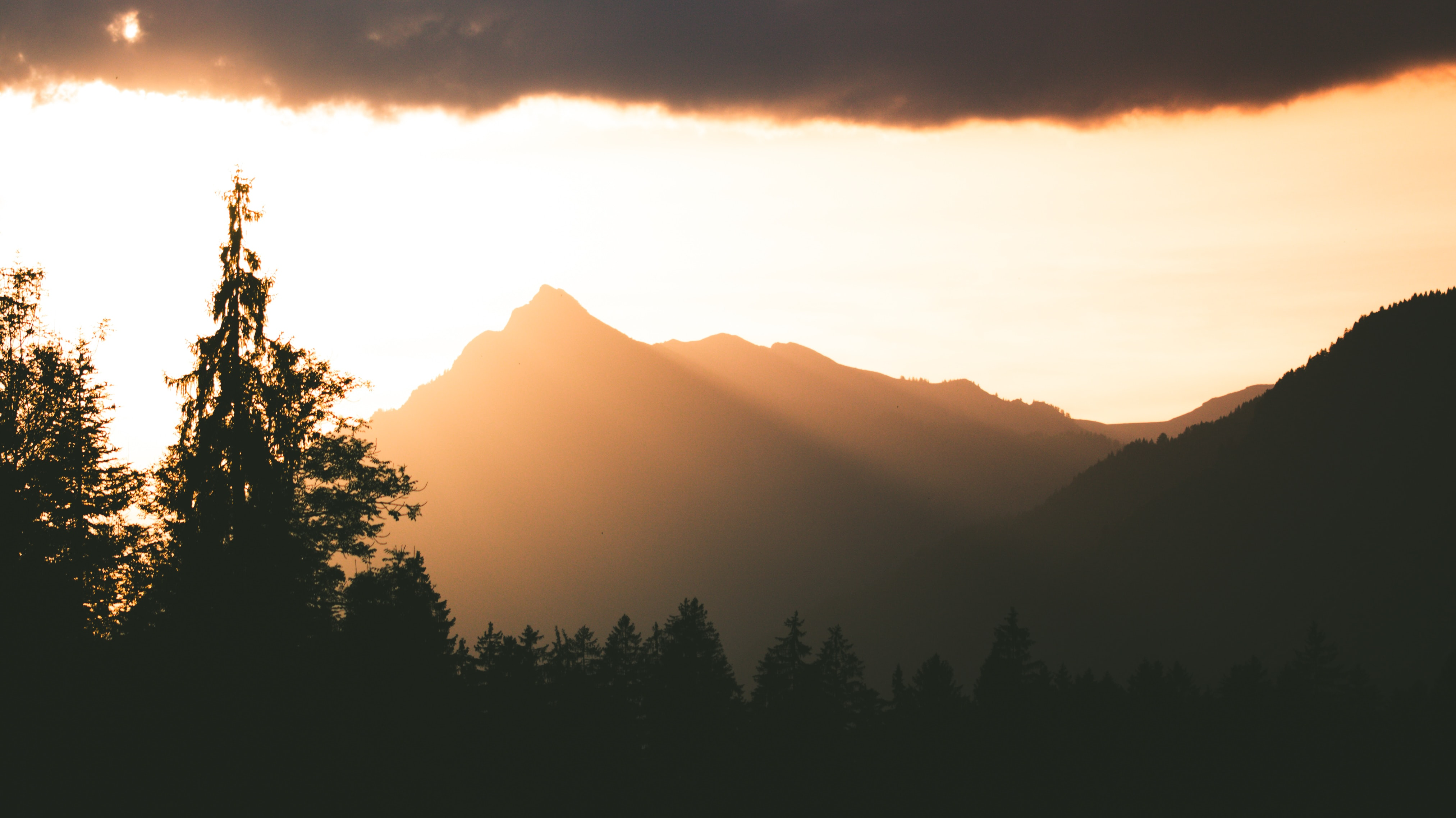 silhouette photography of mountain during golden hour