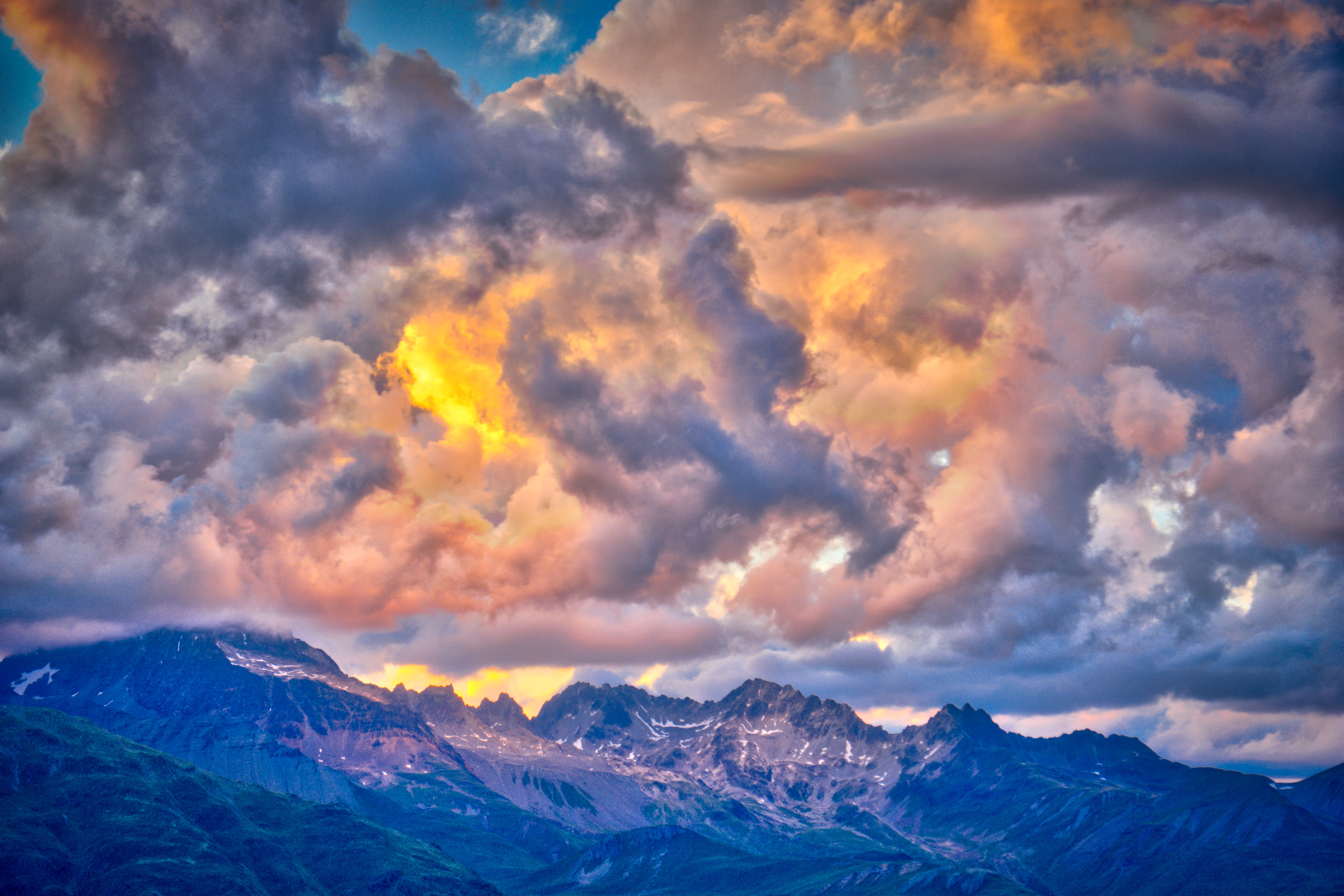 photo of mountain range under golden sky