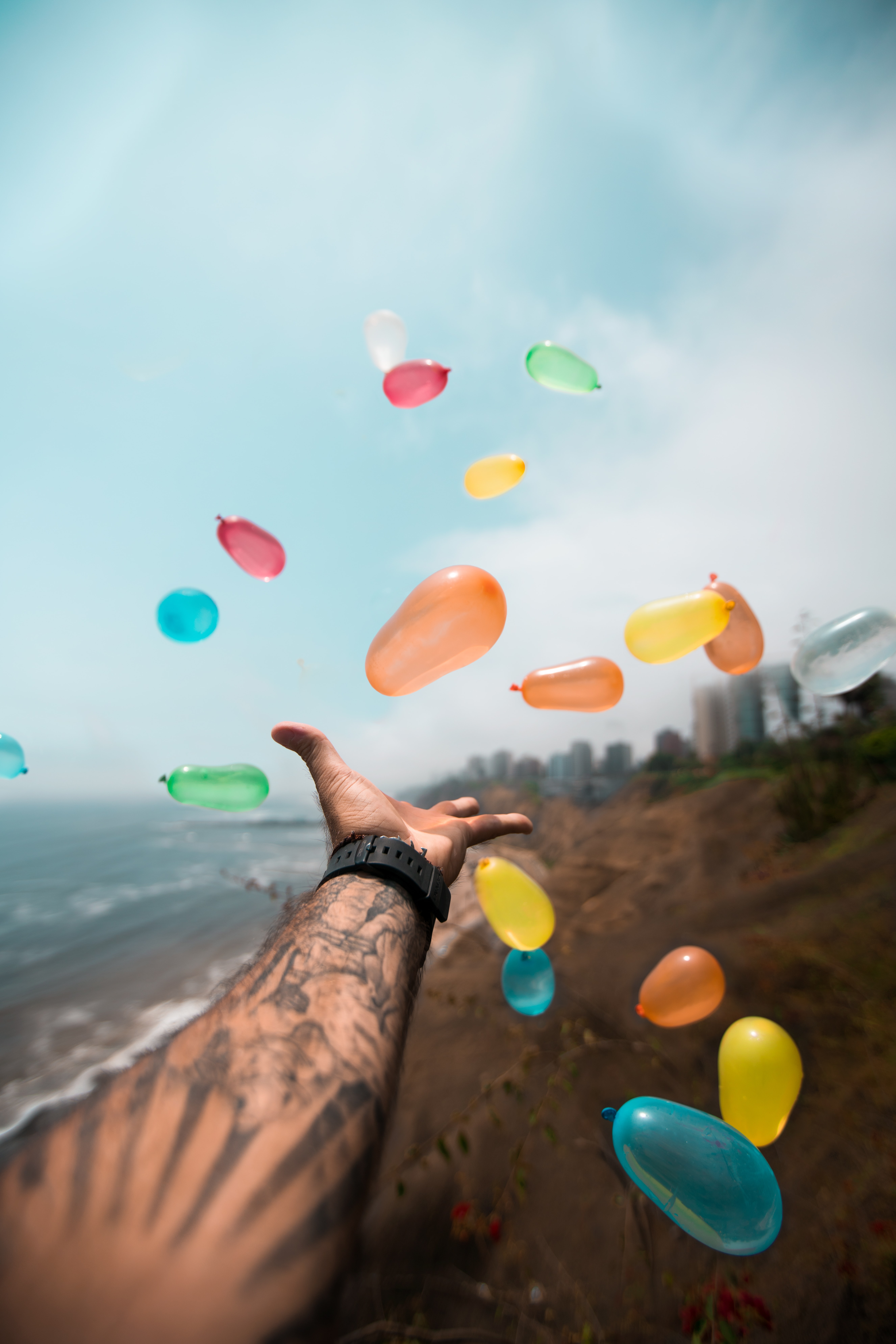 person throwing balloons